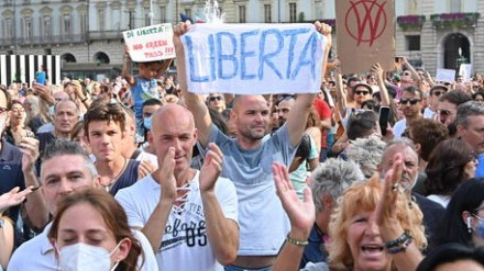 A moment of a manifestation against the Green Pass in Turin, Italy, 24 July 2021.   ANSA/ALESSANDRO DI MARCO